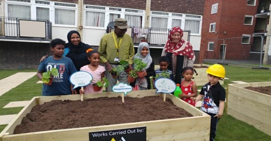 page_17_-_residents_enjoying_their_new_raised_planters_-_cam_estate_-_31st_march_2017